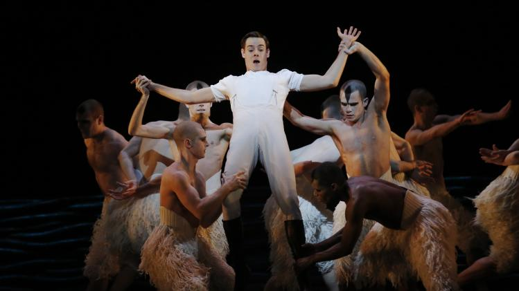 "Dancer Sam Archer performs as the prince with male dancers performing as swans in ""Matthew Bourne's Swan Lake"" during a rehearsal at Sadlers Well's theatre in London"