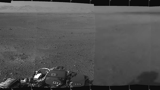This panoramic view comprised of multiple images put together, provided by NASA on Wednesday, Aug. 8, 2012, shows the first 360-degree panoramic view from NASA's Curiosity rover, taken with the Navigation cameras. Mount Sharp is to the right, and the north Gale Crater rim can be seen at center. The rover's body is in the foreground, with the shadow of its head, or mast, poking up to the right.  (AP Photo/NASA)