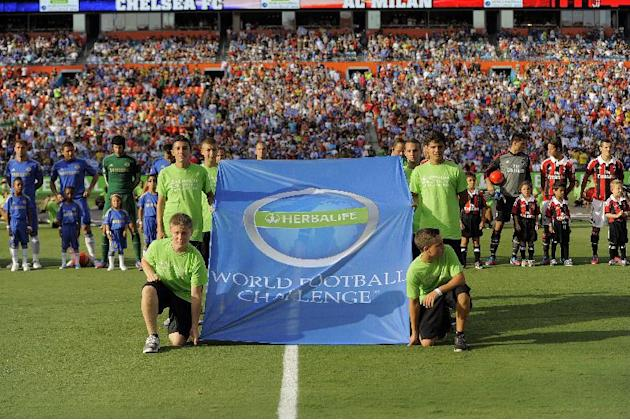 COMMERCIAL IMAGE - In this photograph taken by AP Images for Herbalife, Chelsea FC and A.C. Milan take to the field at the Herbalife World Football Challenge, Saturday, July 28, 2012, at Sun Life Stad