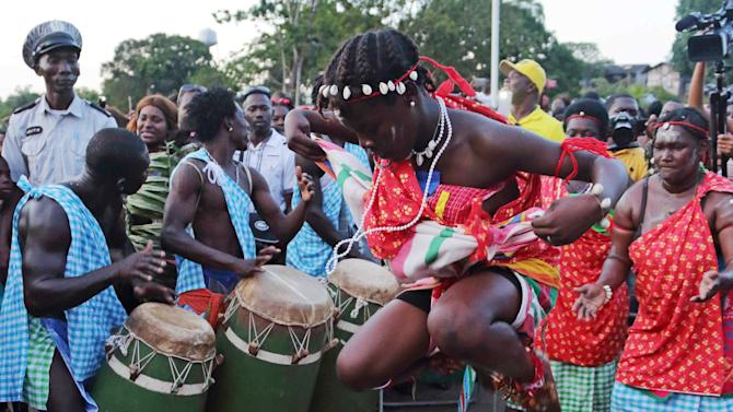 Members of the Maroon community play music and dance during Theater and Dance Festival in Moengo