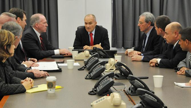 """FILE - In a Sept. 26, 2009, file photo released by the New York City Police Department,  Police Commissioner Raymond Kelly, center, briefs New York police officials and John O. Brennan, center left, assistant to the president for Homeland Security and Counter-terrorism, and Deputy New York Police Commissioner of Intelligence David Cohen, center right, on events surrounding the alleged plot to bomb New York commuter trains, at Police Headquarters in New York. Working with the CIA, the New York Police Department maintained a list of """"ancestries of interest"""" and dispatched undercover officers to monitor Muslim businesses and social groups, according to new documents that offer a rare glimpse inside an intelligence program the NYPD insists doesn't exist.  (AP Photo/NYPD, File)"""