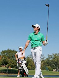 Rory McIlroy of Northern Ireland waits on the seventh tee alongside his caddie J.P. Fitzgerald during the final round of the Tour Championship by Coca-Cola at East Lake Golf Club in Atlanta, Georgia