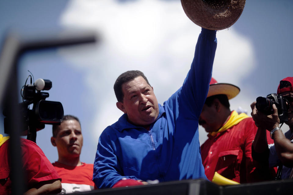 Venezuela's President Hugo Chavez waves to supporters from the top of a vehicle during a campaign caravan from Barinas to Caracas, in Sabaneta, Venezuela, Monday, Oct. 1, 2012. Venezuela's presidential election is scheduled for Oct. 7. (AP Photo/Rodrigo Abd)