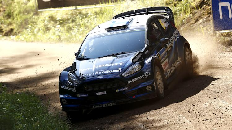 Finnish Mikko Hirvonen with Ford Fiesta takes a corner during the second day of the World Rally Championship in Jyväskylä, Central Finland on Friday, Aug. 1, 2014. (AP Photo/Lehtikuva, Roni Rekomaa) FINLAND OUT
