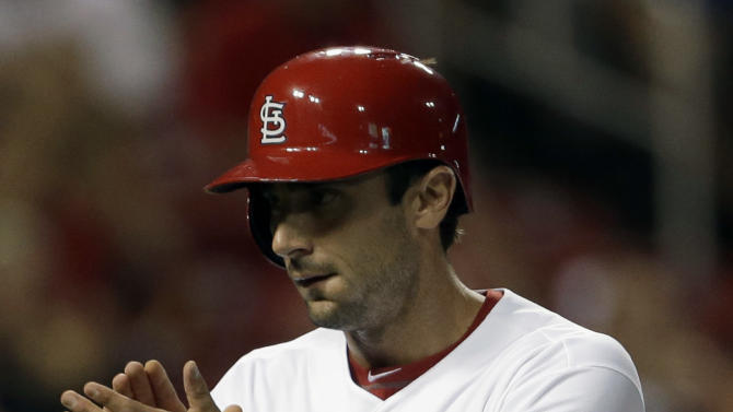 St. Louis Cardinals' Matt Carpenter applauds after scoring on a single by teammate Allen Craig during the first inning of a baseball game against the Kansas City Royals, Thursday, May 30, 2013, in St. Louis. (AP Photo/Jeff Roberson)