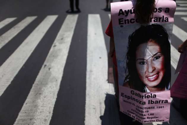 A family member of a missing woman from Ciudad Juarez marches at Reforma Avenue in Mexico City