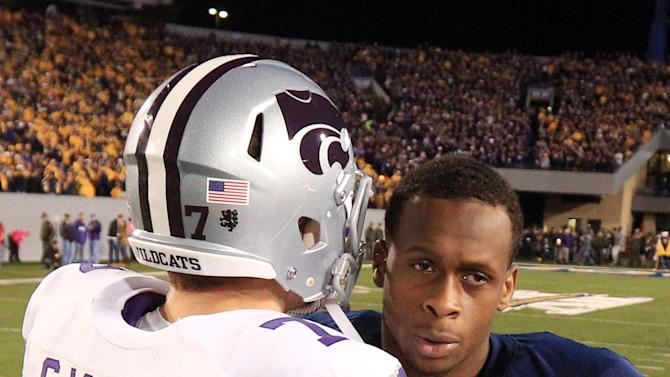 West Virginia quaterback Geno Smith (12) and Kansas State quaterback Collin Klein (7) meet prior to the coin toss at an NCAA college football game in Morgantown, W.Va., Saturday, Oct. 20, 2012. (AP Photo/Christopher Jackson)