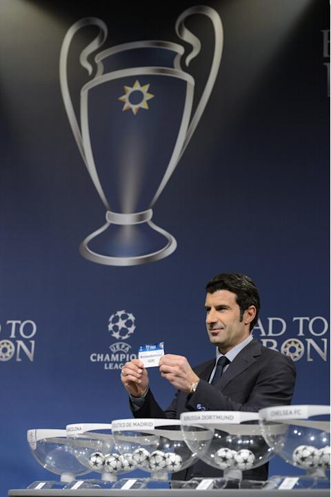 Former Portugal soccer player and Champions League Lisbon final ambassador Luis Figo shows a ticket with German soccer club Borussia Dortmund during the draw of the round of 16 games of UEFA Champions