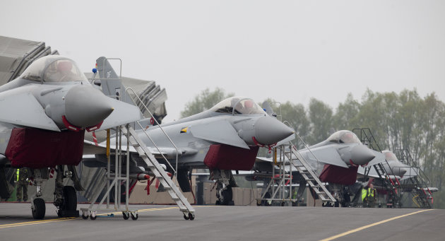 RAF Typhoon fighter aircraft at RAF base Northolt, where four of the aircraft will be based as part of the Olympics related security exercise in west London, Wednesday, May 2, 2012. The Typhoon interceptor aircraft forms a part of a co-ordinated defence against possible threats to the London 2012 Olympic games, involving all three of the British armed services, with high end weaponry including a missile defence system, fighter aircraft and AWACS aircraft. (AP Photo/Alastair Grant)