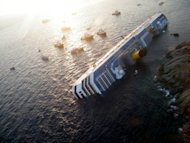 An aerial view of the Costa Concordia, wrecked off the Italian island of Giglio, in January. Experts on Friday refuted claims by Italian Captain Francesco Schettino that he saved lives on the night of the Costa Concondia shipwreck, as pre-trial hearings into the disaster were set to wind up