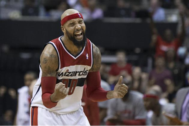 Washington Wizards forward Drew Gooden celebrates a basket during the second half of an NBA basketball game against the Brooklyn Nets on Saturday, March 15, 2014, in Washington. The Wizards defeated t