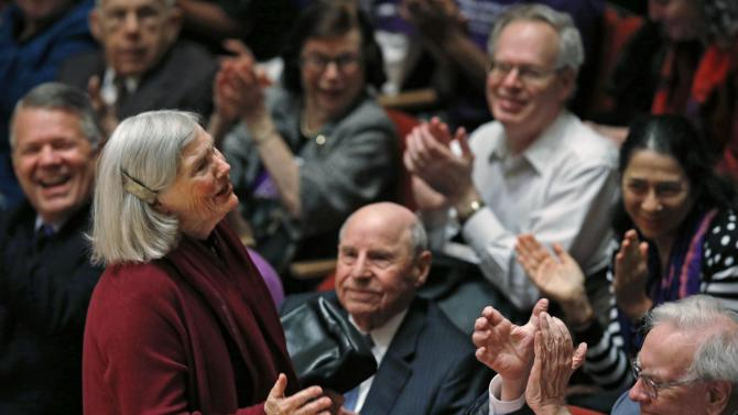 Roberta Buffett Elliott is applauded by her brother Warren Buffett and her husband David Elliott as she is acknowledged during an announcement ceremony at Northwestern University in Evanston