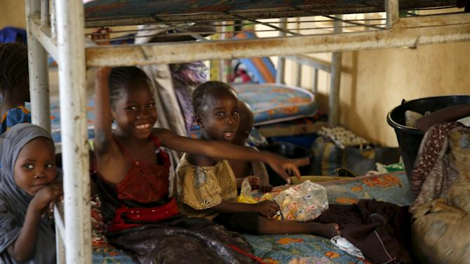 Children rescued from Boko Haram in Sambisa forest react as they rest in a room at the Internally Displaced People's camp in Yola, Nigeria