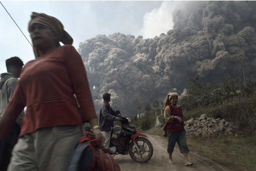 Villagers run as Mount Sinabung erupts at Sigarang-Garang village in Karo district