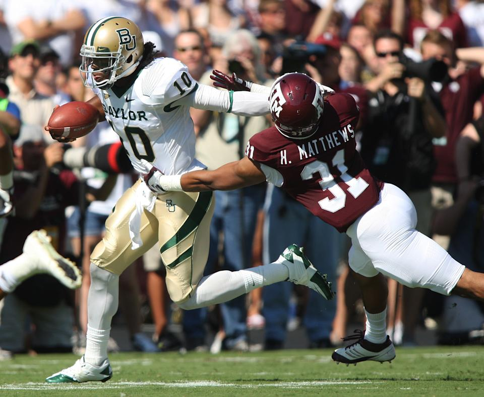 Baylor quarterback Robert Griffin III (10) runs the ball against Texas A&M's Howard Matthews (31) during the first half of an NCAA college football game Saturday, Oct. 15, 2011, in College Station, Texas. (AP Photo/Jon Eilts)