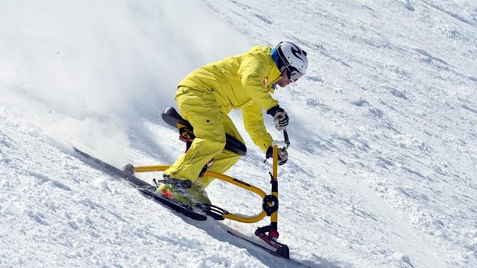 This April 2010 photo provided by Brenter Snowbike shows Floran Schwarzenbacher riding a snowbike at Arapahoe Basin Ski Area in Colorado. Snowbiking is one of a number of activities becoming more widely available in winter recreation destinations as visitors look for diversions beyond skiing and snowboarding. (AP Photo/Brenter Snowbike, Harald Brenter)