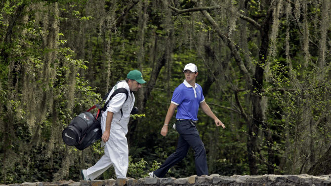 Rory McIlroy, of Northern Ireland, walks across the Nelson Bridget with his caddie J.P. Fitzgerald during the first round of the Masters golf tournament Thursday, April 11, 2013, in Augusta, Ga. (AP Photo/Matt Slocum)