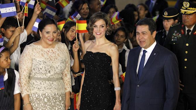 Spain's Queen Letizia, Honduras' President Juan Orlando Hernandez and his wife Ana Garcia pose for a picture before a gala dinner at presidential palace in Tegucigalpa