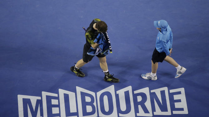 Britain's Andy Murray wipes the sweat from his face during his men's semifinal against Switzerland's Roger Federer at the Australian Open tennis championship in Melbourne, Australia, Friday, Jan. 25, 2013. (AP Photo/Rob Griffith)