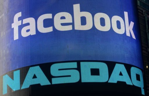 A sign welcoming Facebook is flashed on a screen outside the NASDAQ stock exchange at Times Square in New York