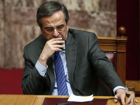 Greece's Prime Minister Samaras reacts during the second of three rounds of a presidential vote at the Greek parliament in Athens