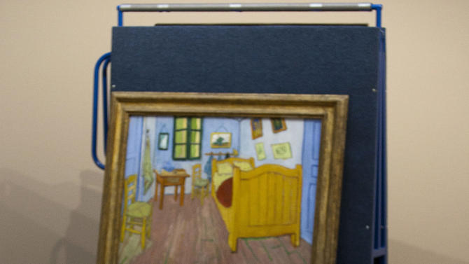 "A Vincent van Gogh's painting ""The Bedroom"" sits on a felt-lined carrier trolley at the Van Gogh Museum in Amsterdam, Netherlands, Sunday, Sept. 23, 2012. While the museum closes for seven months for renovations, 75 works by the Dutch painter will be displayed instead across town at The Hermitage, an Amsterdam satellite of the Russian state museum. The tricky process of transporting the artworks under police escort began immediately after the last visitors left the museum Sunday evening and carried on through the night into Monday morning. The Van Gogh Museum reopens April 25, 2013. (AP Photo/Cris Toala Olivares)"