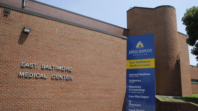 This photo taken July 8, 2014, shows the East Baltimore Medical Center, a community practice affiliated with Johns Hopkins Hospital, in Baltimore. Johns Hopkins Hospital has agreed to a $190 million settlement with more than 8,000 patients of Dr. Nikita Levy, a gynecologist who secretly photographed and videotaped women's bodies in the examining room with a pen-like camera he wore around his neck, lawyers said Monday, July 21, 2014. Levy was working at the East Baltimore Medical Center when the allegations came to light. (AP Photo)