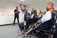 Britain's Prime Minister David Cameron speaks to members of Britain's Paralympic equestrian team during a visit to the athletes village in the Olympic Park last week. Eva Loeffler, a trained physiotherapist who has dedicated much of her own life to promoting disability sport, marvels at how the Paralympics have evolved into a celebration of world-class athleticism