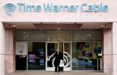A customer leaves a Time Warner Cable store in Palm Springs in this file photo