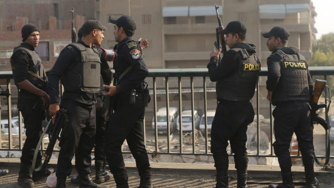Security forces take up positions after closing roads, during an Islamist protest in El-Talbyia