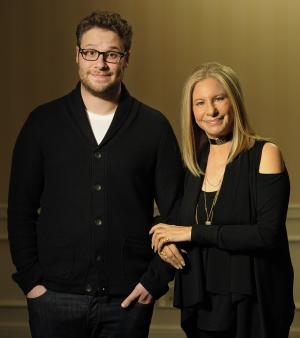 "In this Dec. 11, 2012, photo, Seth Rogen, left, and Barbara Streisand, cast members in the film ""The Guilt Trip,"" pose together for a portrait at The Four Seasons Hotel in Beverly Hills, Calif. (Photo by Chris Pizzello/Invision/AP)"