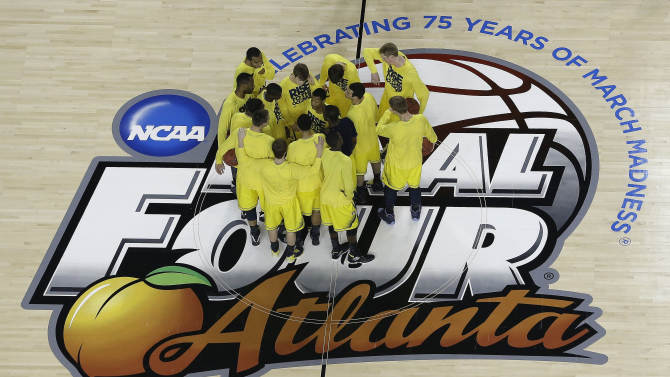 Michigan players huddle before the first half of the NCAA Final Four tournament college basketball championship game against the Louisville, Monday, April 8, 2013, in Atlanta. (AP Photo/David J. Phillip)