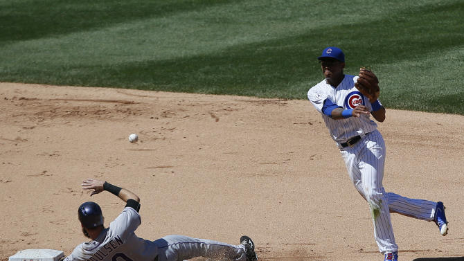 Colorado Rockies' Ben Paulsen is forced out by Chicago Cubs shortstop Addison Russell on a double play hit by Nick Hundley during the fifth inning of a baseball game in Chicago, Wednesday, July 29, 2015. (AP Photo/Andrew A. Nelles)