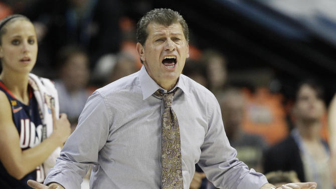 Connecticut head coach Geno Auriemma speaks to players during the first half of the NCAA women's Final Four semifinal college basketball game against Notre Dame, in Denver, Sunday, April 1, 2012. (AP Photo/Eric Gay)