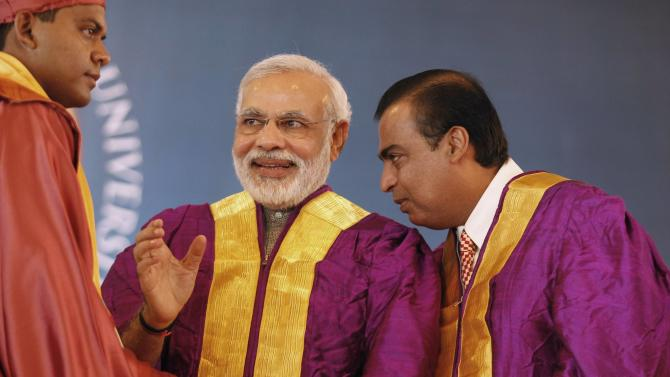 Ambani, chairman of Reliance Industries Ltd, speaks as Gujurat's chief minister Modi reacts while presenting a degree certificate to a student during a convocation ceremony at PDPU, in Gandhinagar