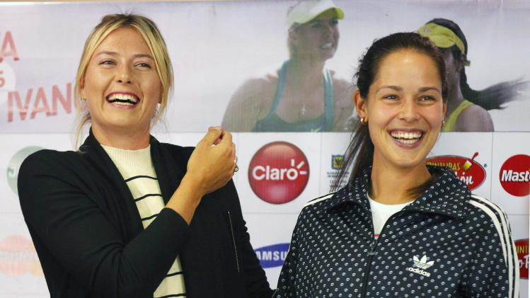 Sharapova of Russia and Ivanovic of Serbia smile after a news conference in Bogota