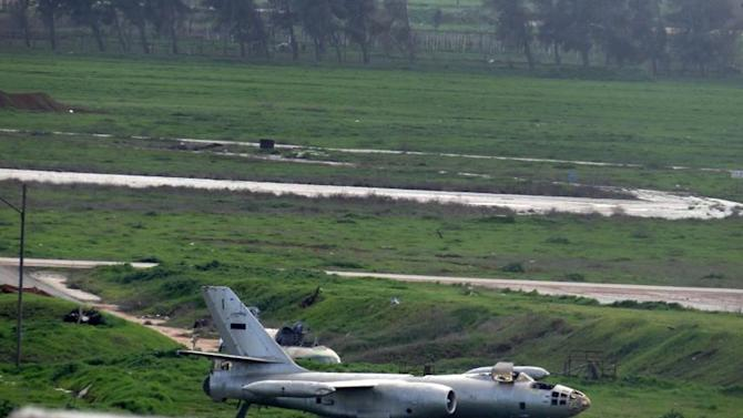 "Citizen journalism image taken on Thursday, Feb. 14, 2013 and provided by Aleppo Media Center, AMC, which has been authenticated based on its contents and other AP reporting, shows Nairab air base in Aleppo province, Syria. Earlier this week, rebels launched a major attack on the Aleppo International Airport and the nearby air base of Nairab capturing most of the ""Brigade 80"" force that is in charge of protecting the area. Activists says scores of soldiers and rebels were killed in the battle this week. (AP Photo/Aleppo Media Center AMC)"
