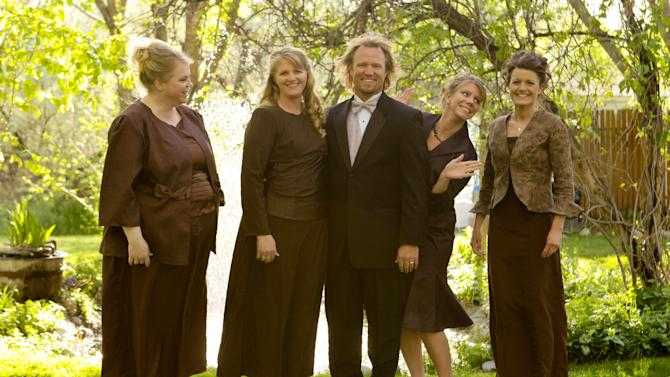 "FILE - In this undated file photo provided by TLC, Kody Brown, center, poses with his wives, from left, Janelle, Christine, Meri, and Robyn in a promotional photo for TLC's reality TV show, ""Sister Wives."" The Browns' attorney, Jonathan Turley, says he will file a lawsuit in Salt Lake City's U.S. District Court on Wednesday, July 12, 2011, challenging the Utah bigamy law that makes their lifestyle illegal. (AP Photo/TLC, Bryant Livingston, File)"