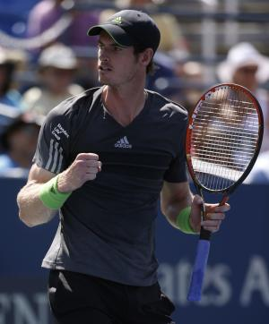 Murray grits through cramps to win at US Open