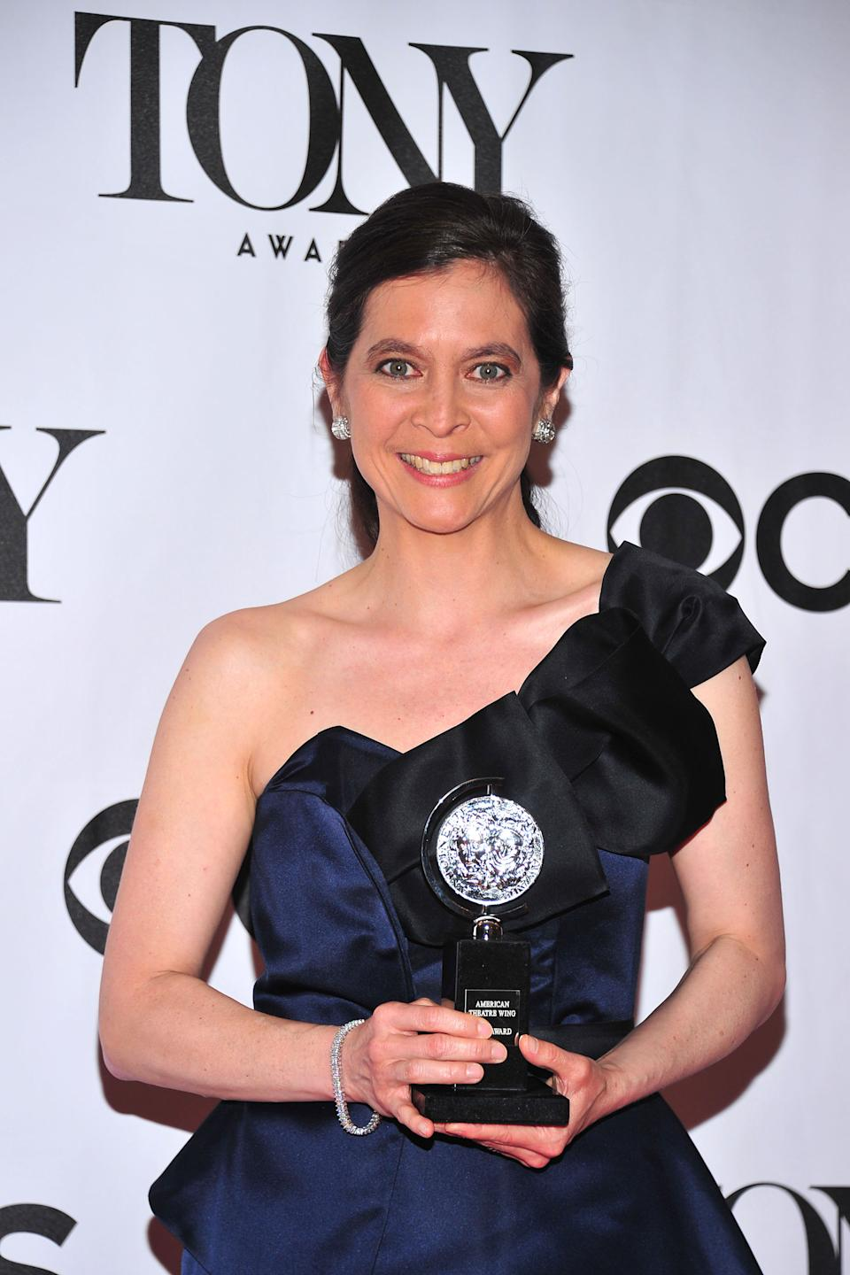 "Diane Paulus poses with her award for best direction in a musical for ""Pippin"" at the 67th Annual Tony Awards, on Sunday, June 9, 2013 in New York.  (Photo by Charles Sykes/Invision/AP)"