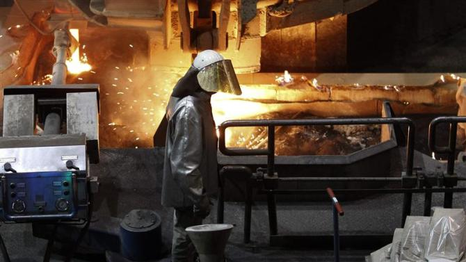 A worker controls the temperature of a casting roller at ThyssenKrupp Steel Europe AG in Duisburg