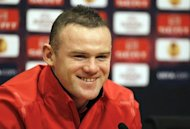 Wayne Rooney, pictured in February 2012, insists Manchester United are capable of clinching the Premier League title with a victory at Manchester City later this month