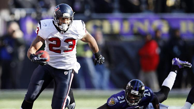 Houston Texans running back Arian Foster leaves Baltimore Ravens cornerback Lardarius Webb in the background as he carries the ball during the first half of an NFL divisional playoff football game in Baltimore, Sunday, Jan. 15, 2012. (AP Photo/Patrick Semansky)