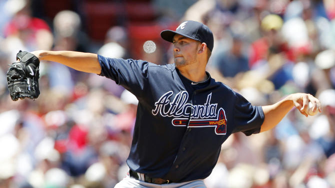Atlanta Braves' Mike Minor pitches in the first inning of a baseball game against the Boston Red Sox in Boston, Sunday, June 24, 2012. (AP Photo/Michael Dwyer)