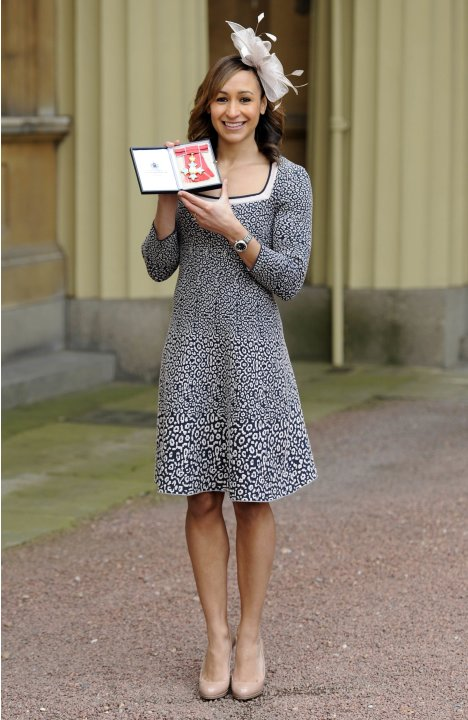 Heptathlete Jessica Ennis poses for photographs after being presented with her CBE medal by Queen Elizabeth during an investiture ceremony at Buckingham Palace in London