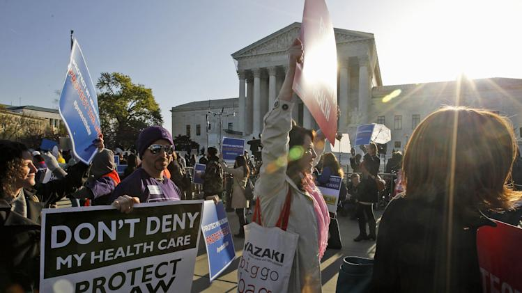 Supporters of health care reform rally in front of the Supreme Court in Washington, Tuesday, March 27, 2012, as the court continued hearing arguments on the health care law signed by President Barack Obama. (AP Photo/Charles Dharapak)