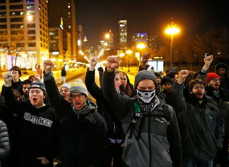 Demonstrators chant as the walk the streets during protests in Chicago