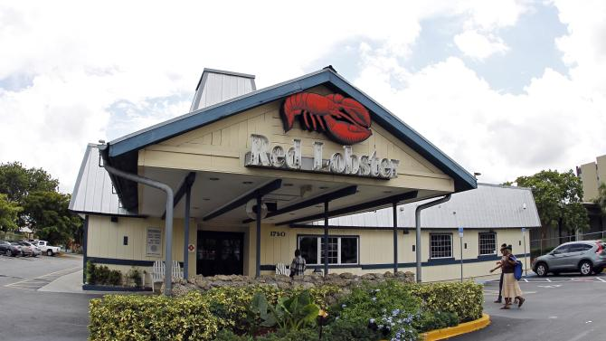 FILE - In this Thursday, Sept. 6, 2012 file photo, a Red Lobster restaurant is shown in Hialeah, Fla. Darden Restaurants Inc. said Friday, Sept. 21, 2012, that its fiscal first-quarter net income rose 4 percent as it prepared to revamp the menu and marketing for its struggling Olive Garden and Red Lobster chains. (AP Photo/Alan Diaz, File)