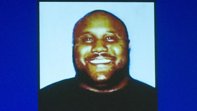 In this image provided by the Irvine, Calif., Police Department via The Orange County Register, former Los Angeles police officer Christopher Jordan Dorner is shown. Dorner is a suspect in the killings of Monica Quan and her fiance, Keith Lawrence, who were found shot to death in their car at a parking structure Sunday night. (AP Photo/Irvine Police Department via The Orange County Register)