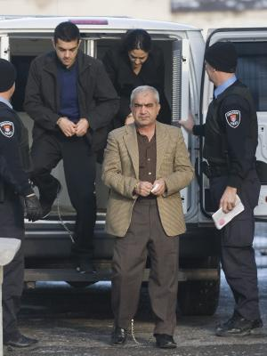 Mohammad Shafia, centre, Tooba Yahya, right, and Hamed Shafia, left, arrive at the Frontenac County courthouse in Kingston, Ontario, Sunday, Jan. 29, 2012. A jury took 15 hours to find Shafia, 58, his wife Tooba Yahya, 42, and their son Hamed, 21, each guilty of four counts of first-degree murder in a case so shocking it has riveted Canadians from coast to coast. (AP Photo/The Canadian Press, Graham Hughes)